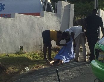 Persons attending to one of the injured in an accident on Virgin Gorda today, June 24, 2017. Photo: Team of Reporters