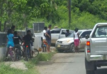 Onlookers at the scene of the accident at Hannah's Estate, Tortola today, August 15, 2017. Photo: Team of Reporters