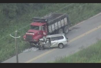 The scene of the fatal crash which involved an SUV and a dump truck. Photo: Channel 2 Action News