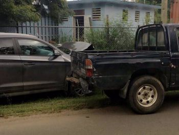 The SUV on the left end up off the road and with extensive frontal damages following a collision on the James Walter Francis Drive today, September 3, 2017. Photo: Team of Reporters