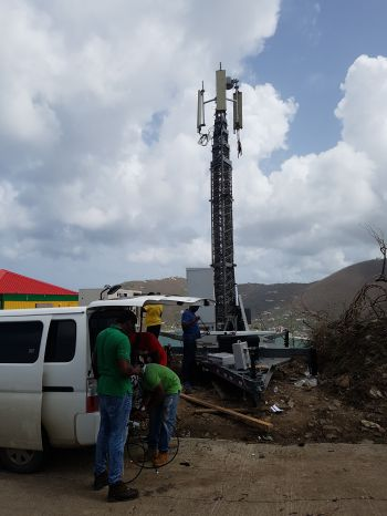 Work being done on one of Digicel's site that was damaged during Hurricane Irma. Photo: Provided
