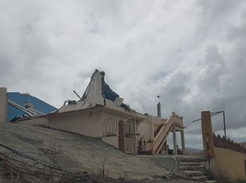 The top flat of this concrete building on Tortola came crashing down during Hurricane Irma. Photo: VINO