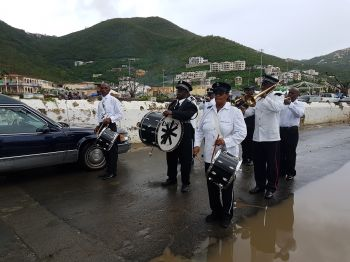 The police marching band at the burial site for Mrs Francia V. James-Liburd. Photo: VINO