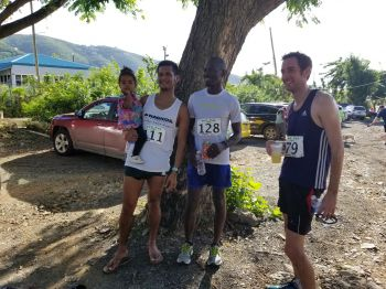 Top three finishers of the Deloitte/Ogier 12th BVI Half Marathon. From left: Reuben J. A. Stoby (2nd), Julius Farley (1st) and Paul Mellor. Photo: VINO