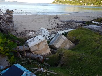 Two tombs that were undermined in a cemetery in Cane Garden Bay, Tortola, during the passage of Hurricane Irma on September 6, 2017. Photo: VINO