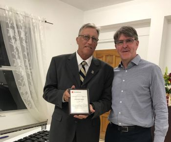 CEO of British Red Cross Mr Mike Adamson, right, presented the Henry Dunant team award to BVI Red Cross Chairman of the Board of Directors Mr Geoffrey H. Brooks, left. Photo: VINO