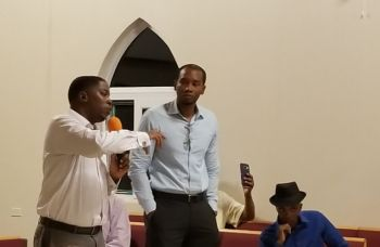 Second District Representative Hon Melvin M. Turnbull, left, makes a point at the public meeting at the Cane Garden Bay Methodist Church on January 25, 2018. Standing right is Deputy Permanent Secretary in the Ministry of Communications and Works Mr Jeremy W. Hodge. Photo: VINO