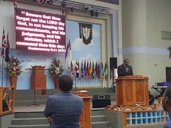 Opposition Leader and Chairman of the Virgin Islands Party Hon Andrew A. Fahie (R1) doing a scripture reading. Photo: VINO