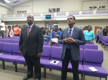 From left: Opposition Leader and Chairman of the Virgin Islands Party Hon Andrew A. Fahie (R1) and Deputy Premier and Minister for Natural Resources and Labour Dr The Honourable Kedrick D. Pickering (R7) at the New Testament Church of God International Worship Centre in Baughers Bay, Tortola, on Sunday, February 4, 2018. Photo: VINO