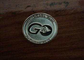 The Go Delta golden pin that loyal customers of Delta Petroleum Caribbean Limited can get. Photo: Team of Reporters