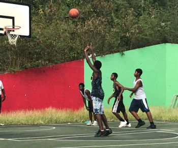 The dominant Kymal T. Panchoo (left) of Albion takes a free throw against Tune Squad at the Sea Cows Bay Basketball Court on February 9, 2018. Photo: Team of Reporters