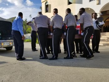 Pallbearers from the Royal Virgin Islands Police Force removing the body of the late Mr M. Elton Georges OBE, CMG following a special viewing at the Sea Cows Bay Methodist Church on April 19, 2018. Photo: VINO
