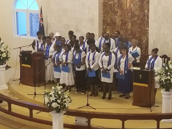 Members of the BVI Diabetes Association offers a song in tribute to the late for President of the BVI Diabetes Association Mr M. Elton Georges OBE, CMG. Photo: VINO