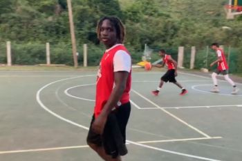Malaki A. Smith netted 30 points to lead Lights Out (red) to victory against Nuttin but Net in the opening game of the Sea Cows Bay Basketball Club (SCBBC) Under 17 Inter-District Tournament at the Sea Cows Bay Basketball Court on Friday July 12, 2019. Photo: Team of Reporters