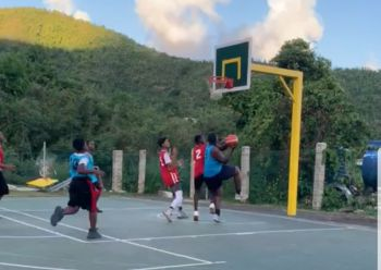 Nuttin but Net's Shaquon George aka 'Big Diesel' goes for a layup against Lights Out in the Sea Cows Bay Basketball Club (SCBBC) Under 17 Inter-District Tournament at the Sea Cows Bay Basketball Court on Friday July 12, 2019. Photo: Team of Reporters
