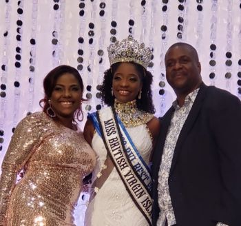 Miss BVI 2019 is flanked by Premier and Minister of Finance Hon Andrew A. Fahie (R1), left, and 'Queen of Caribbean Comedy' and co-host of the 2019 Miss BVI Pageant, Rachel Price. Photo: VINO