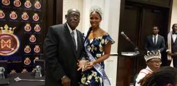 Reigning Mrs BVI Shondrea N. Turnbull, right, presents Dr Robert A. Mathavious with an award for his invaluable contribution towards the Financial Services Industry over the years. Photo: VINO