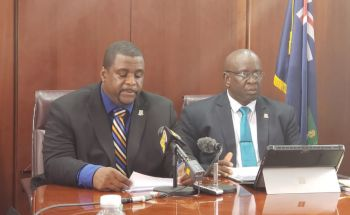 Premier and Minister of Finance Honourable Andrew A. Fahie (R1), left, speaking on negotiations with United Kingdom officials on the UK Loan Guarantee at a press conference held at the House of Assembly Conference Room today, September 17, 2019. Photo: VINO
