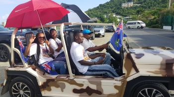Retired sprinter Tahesia G. Harrigan-Scott and quarter miler Ashley N. Kelly are in the motorcade being held in honour of Pan Am Games gold medalist, Chantel E. Malone. Photo: VINO