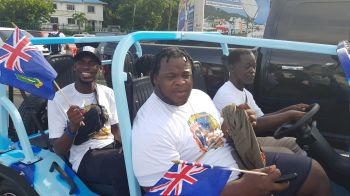 Hurdler Kyron M. McMaster, left, and Shot Putter Eldred Henry, right, during the motorcade for Chantel E. Malone today, October 11, 2019. Photo: VINO