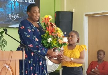 President of the BVI Cancer Society, Ms Gloria A. Fahie is presented with a 'love basket' by member of the Carrot Bay SDA Church, Ms Kimara Scatliffe. Photo: VINO