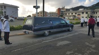 The hearse bearing the casket containing the body of the late Hon Ralph T. O'Neal OBE on Administration Drive this morning, December 11, 2019. Photo: VINO