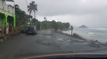 A section of the road at Carrot Bay affected by the sea swells. Photo: VINO