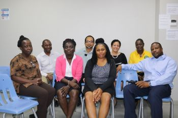 Public Officers along with facilitator Dr. Terence Frater following the Records and Information Management Project workshop. Photo: Provided)
