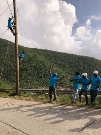 The linemen were brought in by FLOW BVI to assist the BVI Electricity Corporation with reconnecting the Virgin Gorda community. Photo: Flow BVI