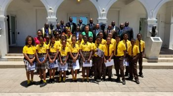 The Honourable Speaker and Members of the House of Assembly were able to interact with the students prior to the Sitting on June 3, 2019 and paused for a moment to take a group photo with the class before they left. Photo: GIS