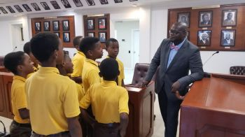 Speaker of the Virgin Islands House of Assembly Honourable Julian Willock interacts with Students of the Ebenezer Thomas Primary School. Photo: GIS