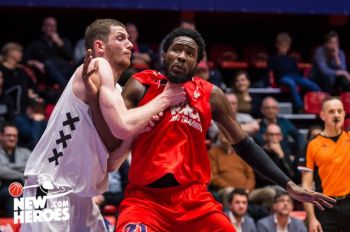 Norville S. Carey aka 'Banana', right, comes under 'attack' defensively from an Aollo Amsterdam player in the Dutch Basketball League. Photo: Facebook