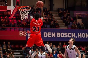 Norville S. Carey aka 'Banana' slam dunks for New Heroes Den Bosch in a recent game against Apollo Amsterdam in the Dutch Basketball League. Photo: New Heroes Basketball