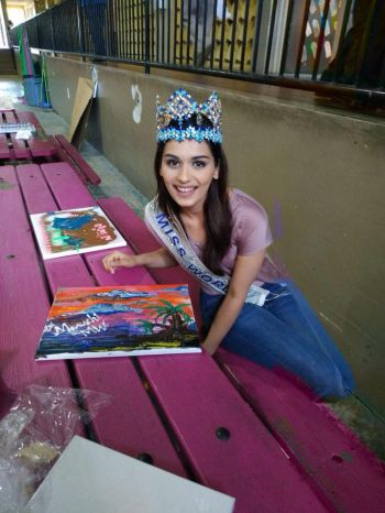 Miss World 2017, Manushi Chhillar signed the finished product of the painting done by her and the student. Photo: Provided