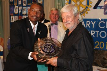 Mr. Micheal Helm (right) receiving his plaque from the Rotary Club of Tortola. Photo: VINO
