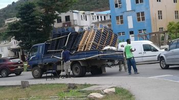 It was a near scare for a driver and crew of a small truck today April 3, 2018 around 12 noon in Road Town when the chairs they were carrying to the back started tipping over. Photo: Team of Reporters