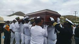 Pallbearers taking the body of Captain Edwin A. George aka Speedy/Kiddo for his funeral on April 14, 2018. Photo: Team of Reporters