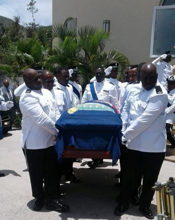Pallbearers taking the body of the late M. Elton Georges to the hearse following his official funeral at the Sea Cows Bay Methodist Church on April 21, 2018. Photo: Team of Reporters