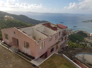 Many homes in the Virgin Islands were left roofless following the passage of hurricanes Irma and Maria in September 2017 and many persons have been finding it difficult to get monies to effect the necessary repairs. Photo: VINO/File