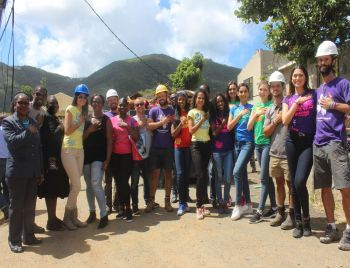 One of the many volunteer groups, All Hands and Hearts at the time assisting the Miss World BVI Committee, along with the Miss World delegation, to rebuild the Eslyn Henley Richiez Learning Centre. Photo: VINO/File