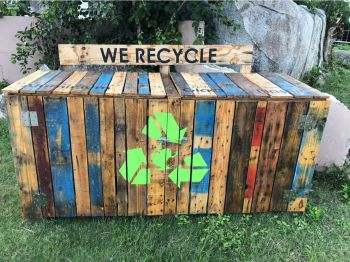 recycling bins that were destroyed in 2017 have been replaced with new and improved eco-friendly wooden recycling bins. Photo: GIS