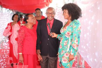 Former Attorney General Lewis S. Hunte QC & Mrs Hunte. Guests were encouraged to record a special video message as they entered the venue before taking individual photos with the woman of the night. Photo: Cecil Alex Jeffrey
