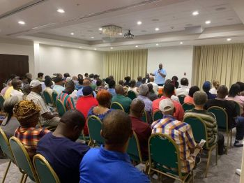 Premier and Minister of Finance Honourable Andrew A. Fahie (R1) addressing taxi and livery operators, and vendors of Cyril B. Romney Tortola Pier Park and Craft Alive in Jost van Dyke Room at Maria's by the Sea on Saturday, March 14, 2020. Photo: VINO
