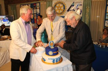 President of the Rotary Club of Tortola Mr. Sam Welch (left) assists Dr Tattersal and Mr Helm with the cutting of the Club's 45th birthday cake. Photo: VINO