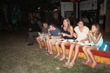 Tourists enjoying the various dishes on offer at the party. Photo:VINO
