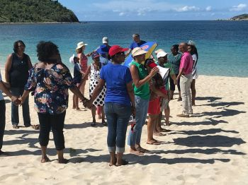 Residents joined with leaders at the Long Bay Beach, at Beef Island, to form a human chain, 'ONE BVI' as part of the Territory's one year observance activities, marking the passage of Hurricane Irma on September 6, 2017. Photo: Facebook