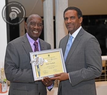 Retiree Mr. Garvin Turnbull presented with certificate by Acting at the time Premier Dr. the Honourable Kedrick D. Pickering. Photo: Ronnielle Frazer/GIS