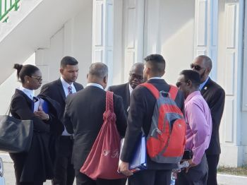 The scene outside the courthouse yesterday, April 12, 2019 as HoA Speaker, Julian Willock speaks with legal minds. Photo: Team of Reporters