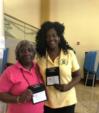 Permanent Secretary (ag), Ms Carolyn Stoutt-Igwe and Supervisor of Elections, Ms Juliette Penn displaying their Observer Passes. Photo: GIS