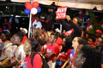 "Hitting directly at the Hon Andrew A. Fahie (AL) led VIP party, Hon Walwyn said, ""The last time I checked the bottom of the gutter was green. My colour is one of strength, determination and love. Our colour is red and the gutter is not for me,"" he told his supporters gathered at the rally. Photo: Facebook"